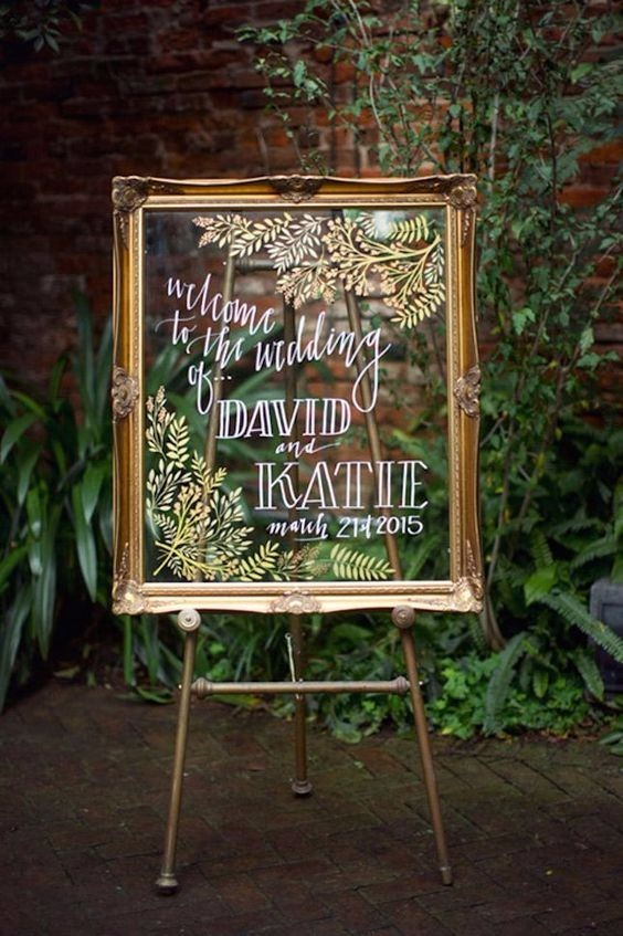gilded glass frame wedding sign